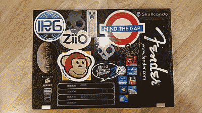 Screenshot showing a Lenovo laptop with numerous stickers